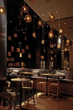 I love the hanging lights ... they create a gorgeousatmosphere in this wine bar & restaurant ...beautiful parquetry flooring too.