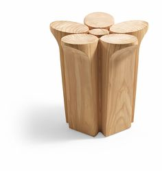 Fiore stool by Karim Rashid for Riva 1920. Stool made from a single block of aromatic cedar with its shape inspired by the natural world. The products are made from completely natural wood, hand-finished without the addition of any treatment. www.karimrashid.com/   http://www.riva1920.it/en/prodotti/stools/fiore/
