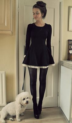 A lovely black dress with white lace peeking out.