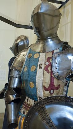 Parts of Armor made for the Spanish Nobelman Don Sancho de Avila in Augsburg Germany 1560 CE with reproduction heraldic tunic