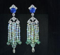 Cartier Front Antiques Biennial 2010. The earrings consist of sapphires, briolette diamonds, emeralds, opal balls, brilliant-cut diamonds.