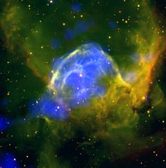 This brightly coloured scene shows a giant cloud of glowing gas and dust known as NGC 2359. This is also dubbed the Thor's Helmet nebula, due to the arching arms of gas stemming from the central bulge and curving towards the top left and right of the frame, creating a shape reminiscent of the Norse god's winged helmet.  http://xmm.esac.esa.int/external/xmm_science/gallery/public/level3.php?id=1195