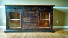 Handcrafted custom sideboard from reclaimed 150 yr. Old pine .   A uthentic aged  milkpaint finish