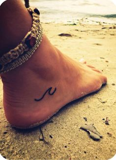 """Small foot tattoo. Little wave. """"I preferred to look at the sea, which said nothing and never made you feel alone."""""""