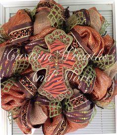 Breathtaking fall mesh wreath with a wooden cross (leopard and zebra) absolutely stunning in orange tones, brown tones, burlap and green. Fall Mesh Wreaths, Door Wreaths, Christmas Wreaths, School Wreaths, Peacock Wreath, Baseball Wreaths, Mardi Gras Wreath, Decorating Ideas, Craft Ideas