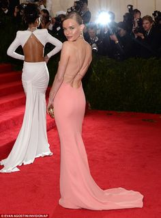 Pictured of elegance: Kate Bosworth wore a soft pink gown that clung to her every contour alongside Rihanna