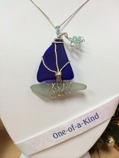 COBALT BLUE & SEA FOAM GREEN SEA-GLASS SAILBOAT PENDANT - Linda Rae Dixon creates art with gems of sea glass that have been perfected by nature and found by her on local beaches.  I search, find and repurpose treasures from the past turning them into beautiful creations of the present. Let me take your sea-glass and create a beautiful custom design for you. Lindaraedixon@gmail.com