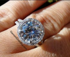 Delicate Halo with a 3 carat center diamond available at DiamondDirectBuy.com under $24K