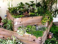Stack wooden crates to create a sweet garden planter. Fairy garden accessories optional!