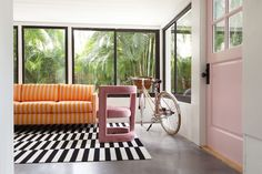 Blair Eadie of Atlantic-Pacific matched her Florida vacation home with her highly curated fashion aesthetic Striped Couch, Florida Home, Florida Vacation, Womb Chair, Double Glass Doors, Pink Tiles, Atlantic Pacific, H&m Home, Design Within Reach