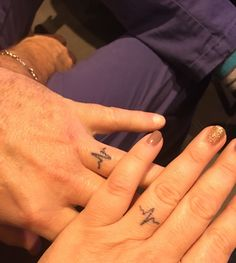 Ring finger tattoo of heartbeats for happily married couple. Designed by Scott and Martha Bowles is Austin, Texas
