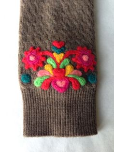 Upcycling old sweater: needle felted wristlet
