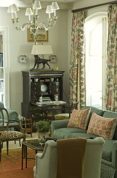 6 Serene Green Paints That Don't Say Green | lovely living room by Cathy Kincaid | Benjamin Moore Richmond Gray HC-96 Is a good neutral khaki green