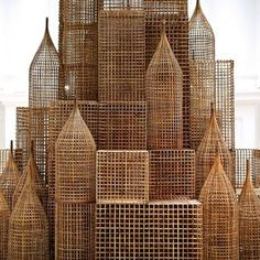 """Cambodian artist Sopheap Pich develops large-scale sculptures that draw on the history of his native country, daily life and own personal experiences and surroundings. His installation """"Compound"""" is a construction using agricultural and craft materials found throughout Cambodia: bamboo, metal wire, plywood and rattan, developed as a response to the dramatic progress of urban development and its detrimental effects on the environment."""
