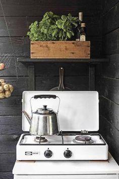 Outdoor kitchen in a tour of Johanna Lehtinen's idyllic Finnish summer cabin in the archipelagos.