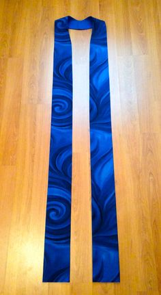 This is a beautiful handmade clergy stole. The blue cotton fabric comes alive in swirling motion creating a modern stole perfect for Advent. The