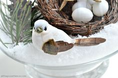 winter nesting make a winter y scene in a glass bowl, crafts, seasonal holiday decor, Nestle the birds in the nest or alongside