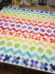 row by row rainbow quilt.