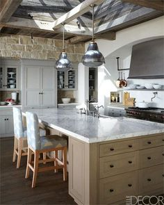 Kitchen Cabinetry and island are custom made, and the antique light fixtures are Belgian. ~ M. Elle Design Mediterranean Architecture in California