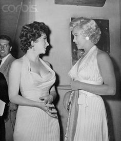 Marilyn with Gina Lollobrigida, at the Trans-Lux Theater, 01 September 1954.