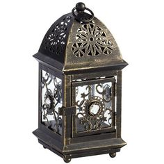 This mini indoor/outdoor lantern is just the right size for a tealight. Covered in detailed ironwork, it could be part of the centerpiece at your next get-together. Or scatter several around the garden for a magical glow.