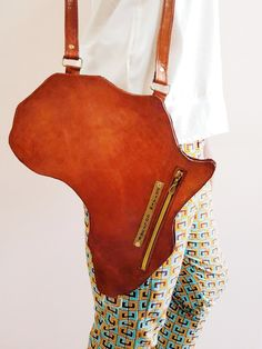 A Vintage Style leather bag designed in the shape of AFRICA. A unisex collection inspired by the diverse beauty, art, culture and people of Africa who continue to inspire the world with Style. [Alkebulan Bag | Brown]