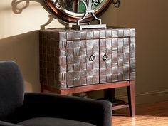 The Woven Leather Chest - A simple storage unit elevated by its luxurious leather surroundings!