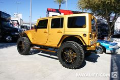 UNIQUE GOLD JEEP 4 DOOR WITH CUSTOM RIMS TIRES AND COLORS