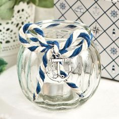 Accentuate your table decor and color scheme with these nautical glass tea light holder favors and watch the room illuminate with the glow of your anchored love.  #NauticalWeddingFavors #GlassTeaLightHolderFavors #NauticalFavorIdeas