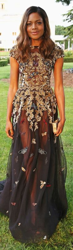 Who made Naomie Harri's black sequin gown?