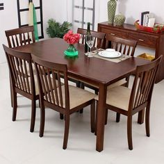 #SolidWood dining tables for chic dining rooms.