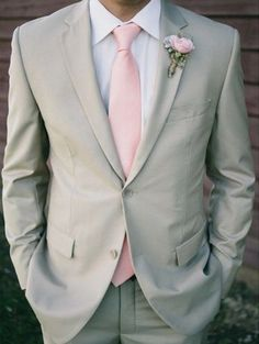 dove grey suit, a pink tie and a pink flower boutonniere