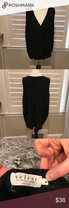 Velvet by Graham & Spencer blouse 100% rayon high low black sleeveless medium blouse. There is a snap in the front at the bottom of the V-neck. Excellent condition. Velvet Tops Blouses