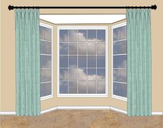 When there's wall space on either side of the bay window, hang your rod high and flank the bay with drapery panels.