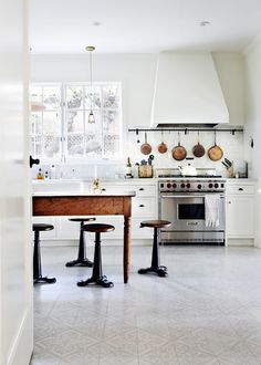 """Despite bringing the Swedish furniture home, Larson really struggled finding materials that felt true to the house. """"It was heartbreaking when we couldn't save the kitchen floor,"""" she said. """"So we..."""