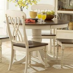 Homelegance [52109-113557] 1393-48 - Ohana Round Dining Table $515.00; chairs priced separately