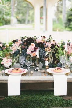 These fig and flower centerpieces are so luxurious.