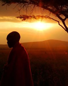 Sunset falls on a Maasai boy on Kenya's Masai Mara National Reserve.  Photograph by Jen Eudy, My Shot