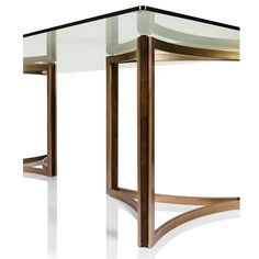 The geometric shape of the matte gold base with insets of dark fumed oak sets a modern tone for this simply elegant dining table.