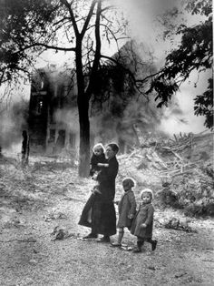 Belgian Refugee with her children Amid Bombed Out Area Saw this picture at the museum of science and industry and the image has stuck with me.