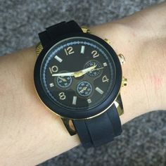 "Black & Gold Watch Let me know you'd like to purchase and I will create a listing for you! Black & Gold watch with a rubber wrist band and gold plated base. The metal is lead and nickel free. Hook and loop buckle. Watch face has a 1.5"" diameter. Adjustable up to approximately 8"". So cute! Also available in white. T&J Designs Accessories Watches"