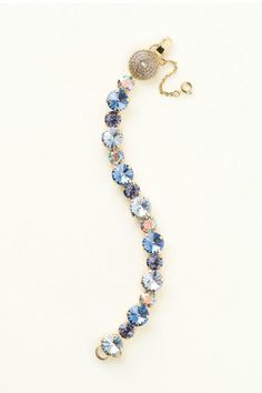 """Bling up your arm with this Swarovski Crystal Bracelet !! This is done in a variation of Blue and crystal tones set in a gold setting. The clasp is a round hinge with a chain clasp to secure the closure. It measures 7""""L 3/8""""W . It's all about the arm candy today. This a classic piece of crystal that can be worn to a dressy affair or on a Saturday night date.  Swarovski Crystal Bracelet  by Styles Boutique. Accessories - Jewelry - Bracelets Boca Raton Florida"""