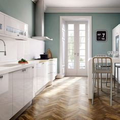 White gloss and lovely green walls and the most beautiful parquet floor!