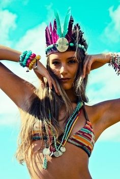 Modern Hippie American Indian ethnic inspired feather headband and layered necklaces with boho chic bikini top. For the BEST Bohemian fashion trends FOLLOW https://www.pinterest.com/happygolicky/the-best-boho-chic-fashion-bohemian-jewelry-gypsy-/ now