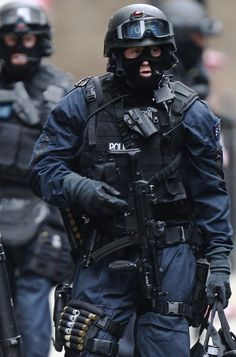 Armed police officers on the scene where a man threaten to blow himself up in an office building on Tottenham Court Road on April 27, 2012 in London, England.