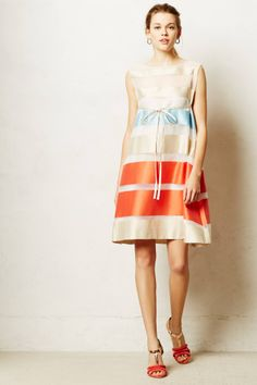 I'm not sure what I love about this dress but I find it absolutely stunning.  It rings Grace Kelly to me.... Organza Swing Dress - anthropologie.com