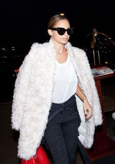 Nicole Richie in a fuzzy jacket and oversize sunglasses