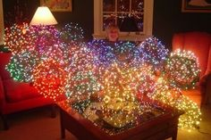 Outdoor Christmas light spheres that hang from your tree! Greensboro, NC has got it goin' on!