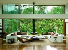 COCOCOZY: DANGLING FIREPLACE  FLOATING STAIRS IN A HOME WITH A TROPICAL VIEW!