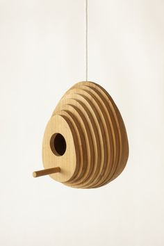 http://www.archipanic.com/birdhouses/ BIRDS HOUSES Tree Ring by Jarrod Lim Reminds me of a honey comb. Don't know why.
